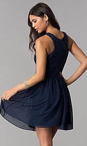 Image of navy blue short lace-bodice homecoming dress. Style: MCR-2553 Back Image