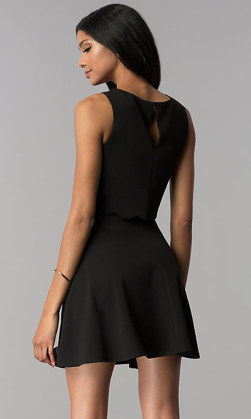 Image of a-line short black popover-bodice party dress. Style: JU-10816 Back Image