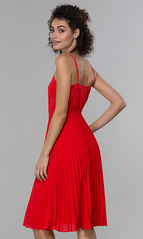 Image of faux-wrap wedding guest dress with pleated skirt. Style: PLA-AJ-705-0479 Back Image