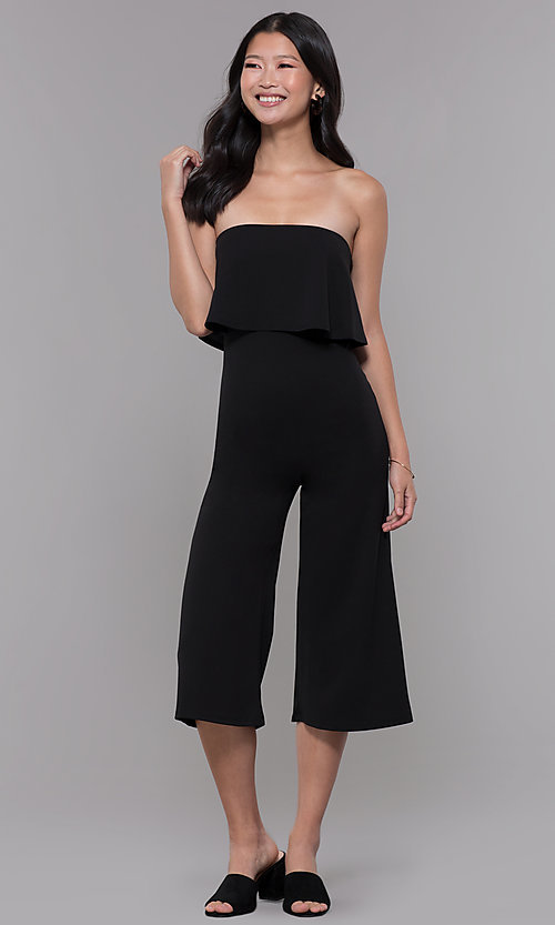 Image of black strapless popover knee-length party jumpsuit. Style: BLU-BR1288 Front Image