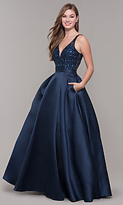 Image long navy v-neck prom dress with beaded bodice. Style: JT-682 Front Image