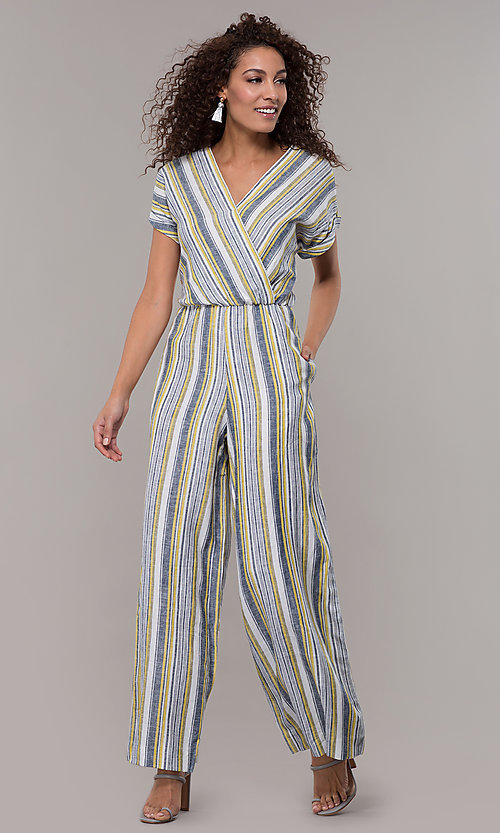 Image of short-sleeve striped long jumpsuit with pockets. Style: ECI-720476-8099A Front Image