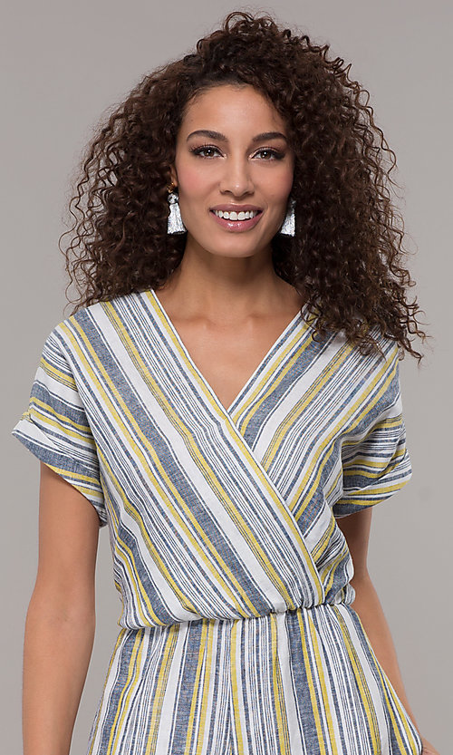 Image of short-sleeve striped long jumpsuit with pockets. Style: ECI-720476-8099A Detail Image 1