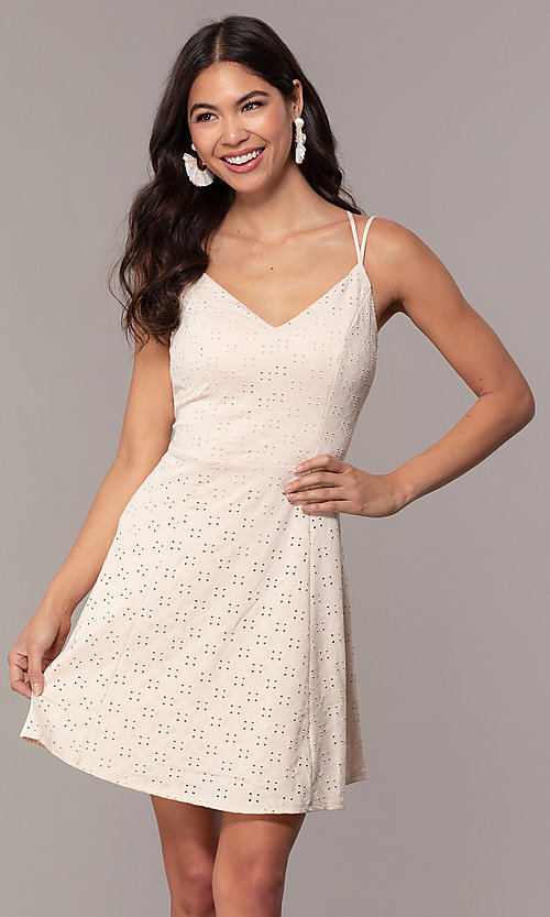 Image of short eyelet v-neck graduation dress in blush pink. Style: EM-FLU-3760-690 Front Image