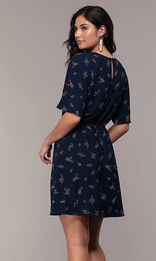 Image of short floral-print party dress with short sleeves. Style: AS-A139547A31 Back Image