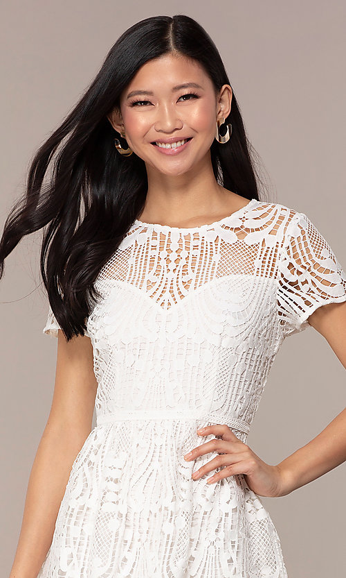 Image of short white lace graduation dress with sleeves. Style: MT-9655 Detail Image 1