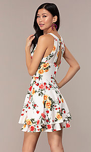 Image of floral-print short tiered graduation party dress. Style: EM-HIA-3967-150 Back Image