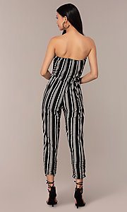 Image of striped strapless party jumpsuit with ruching. Style: IK-RKJ4033 Back Image
