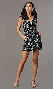 Image of ivory print short black casual party romper. Style: AS-A167545E25 Front Image