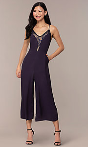 Image of cropped-leg lace-trimmed v-neck jumpsuit for parties. Style: AC-NA73884A Front Image