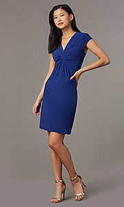 Image of short navy blue empire-waist party dress. Style: ECI-720478-7749A Detail Image 2