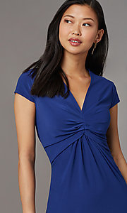 Image of short navy blue empire-waist party dress. Style: ECI-720478-7749A Detail Image 1