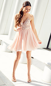 Image of short sequin-bodice homecoming dress by PromGirl. Style: MCR-PL-2600 Detail Image 7