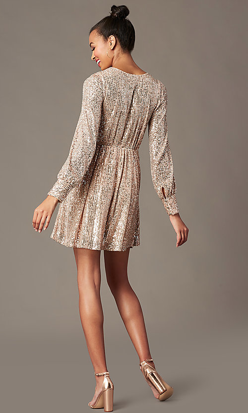 Image of short sequin holiday party dress in blush pink. Style: EM-HOI-4293-690 Back Image