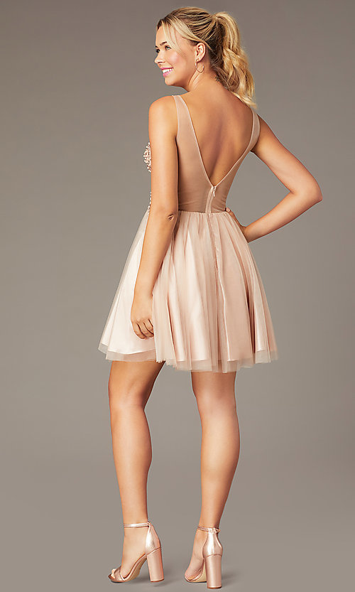 Image of beaded short homecoming tulle dress by PromGirl. Style: NA-PL-G694 Back Image