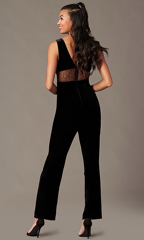 Image of black velvet holiday jumpsuit with sheer lace. Style: BLU-IBR96538 Back Image