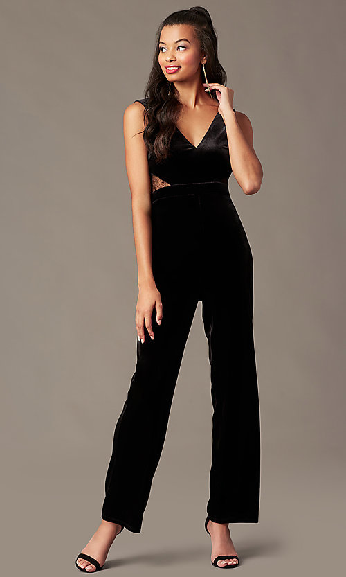 Image of black velvet holiday jumpsuit with sheer lace. Style: BLU-IBR96538 Front Image