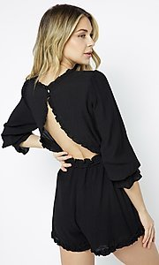 Image of short black casual party romper with sleeves. Style: LAS-ILL-21-IM6050 Back Image