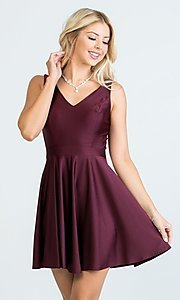 Image of short sleeveless simple fit-and-flare party dress. Style: LAS-LSC-21-25589 Front Image