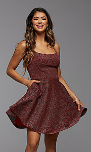 Image of strappy open-back short glitter homecoming dress. Style: PG-BHC-21-28 Front Image