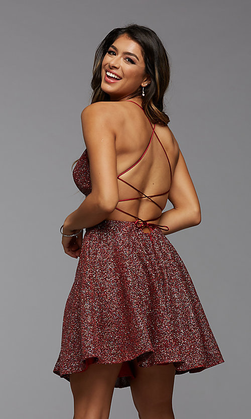 Image of strappy open-back short glitter homecoming dress. Style: PG-BHC-21-28 Back Image