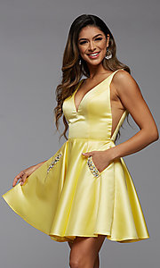 Image of short satin homecoming party dress with sheer sides. Style: PG-FHC-21-03 Front Image