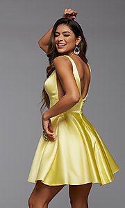Image of short satin homecoming party dress with sheer sides. Style: PG-FHC-21-03 Back Image