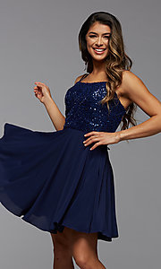 Image of short homecoming dance dress with strappy back. Style: PG-THC-21-44 Front Image