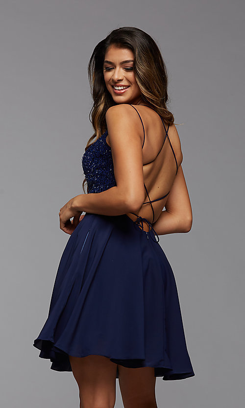 Image of short homecoming dance dress with strappy back. Style: PG-THC-21-44 Back Image
