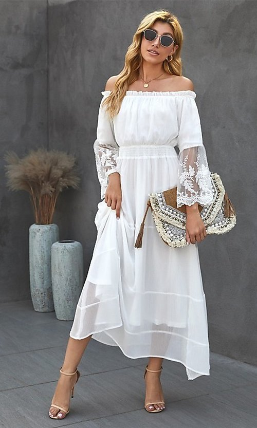 Image of Bohemian white maxi dress with lace bell sleeves. Style: FG-SHI-21-SW611985 Front Image