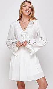 Image of white short party dress with long bell sleeves. Style: FG-ECR-21-ED16228TNA Front Image