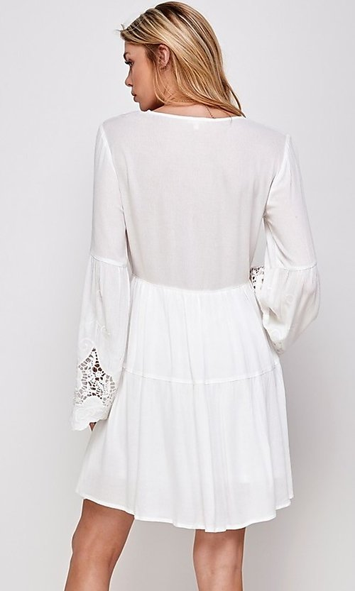 Image of white short party dress with long bell sleeves. Style: FG-ECR-21-ED16228TNA Back Image