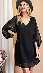 Image of Swiss dot short shift party dress with sleeves. Style: LAS-EES-21-DK4514 Front Image